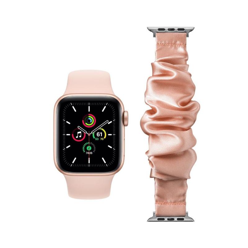 Conjunto composto por Apple Watch SE GPS 40 mm dourado e bracelete adicional Loop Pop pêssego
